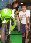 Tono with his wife Hime on the works 250 racer