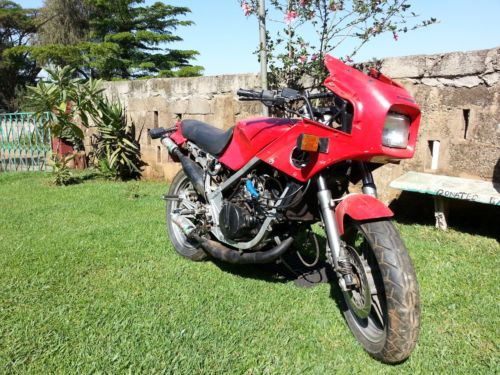 KR250 being broken for parts in Kenya